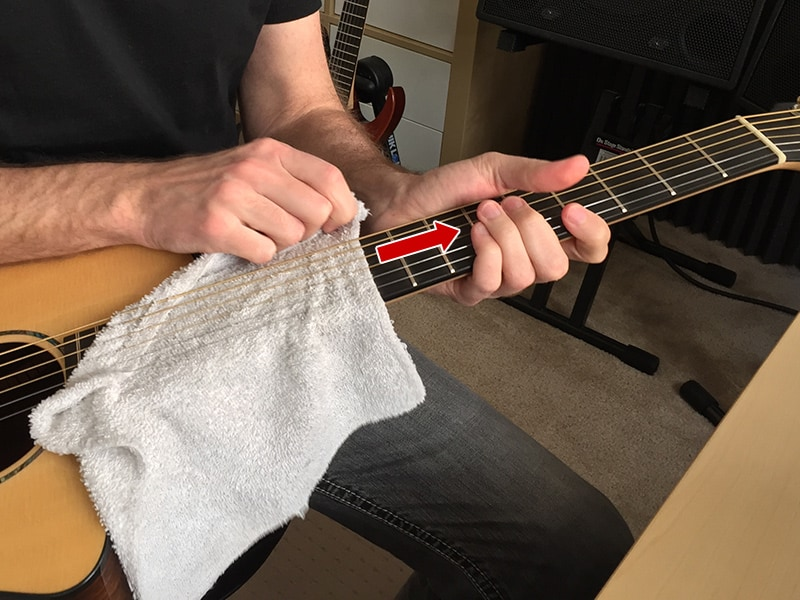 Do this setting on the floor--it'll be easier to hold the guitar safely. I'm setting on a chair here, but that's just to make the picture easier. It's actually not practical for a real cleaning. You might drop the guitar if you try doing this while setting on a chair.