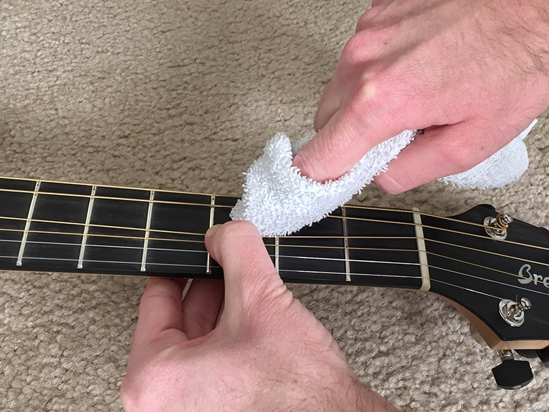 5. Spot clean the fretboard if any areas are especially dirty