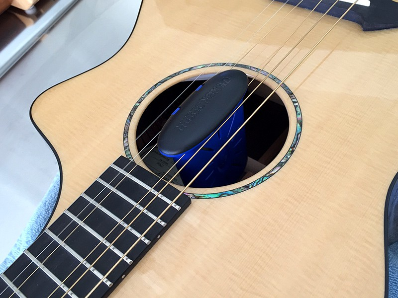 The Humitar is held securely in place between the strings