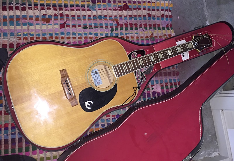 Inside, I found an Epiphone FT-350 in pretty good shape, probably from the 1970's. A guitar of this quality, while not ultra high-end, should NOT be left out in a garage where there is no climate control.
