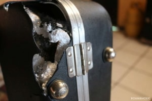 A guitar case damaged during air travel