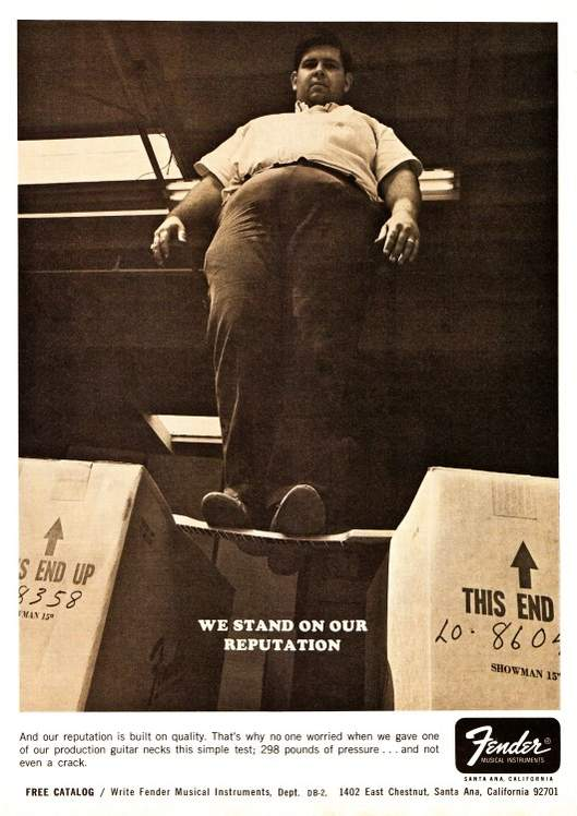 Vintage Fender Guitars ad showing a heavyset employee standing on a neck