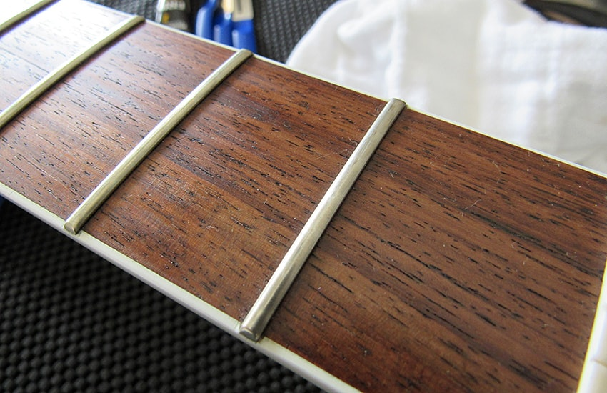 These frets have become dull, hazy, and aren't as smooth to bend on as they once were
