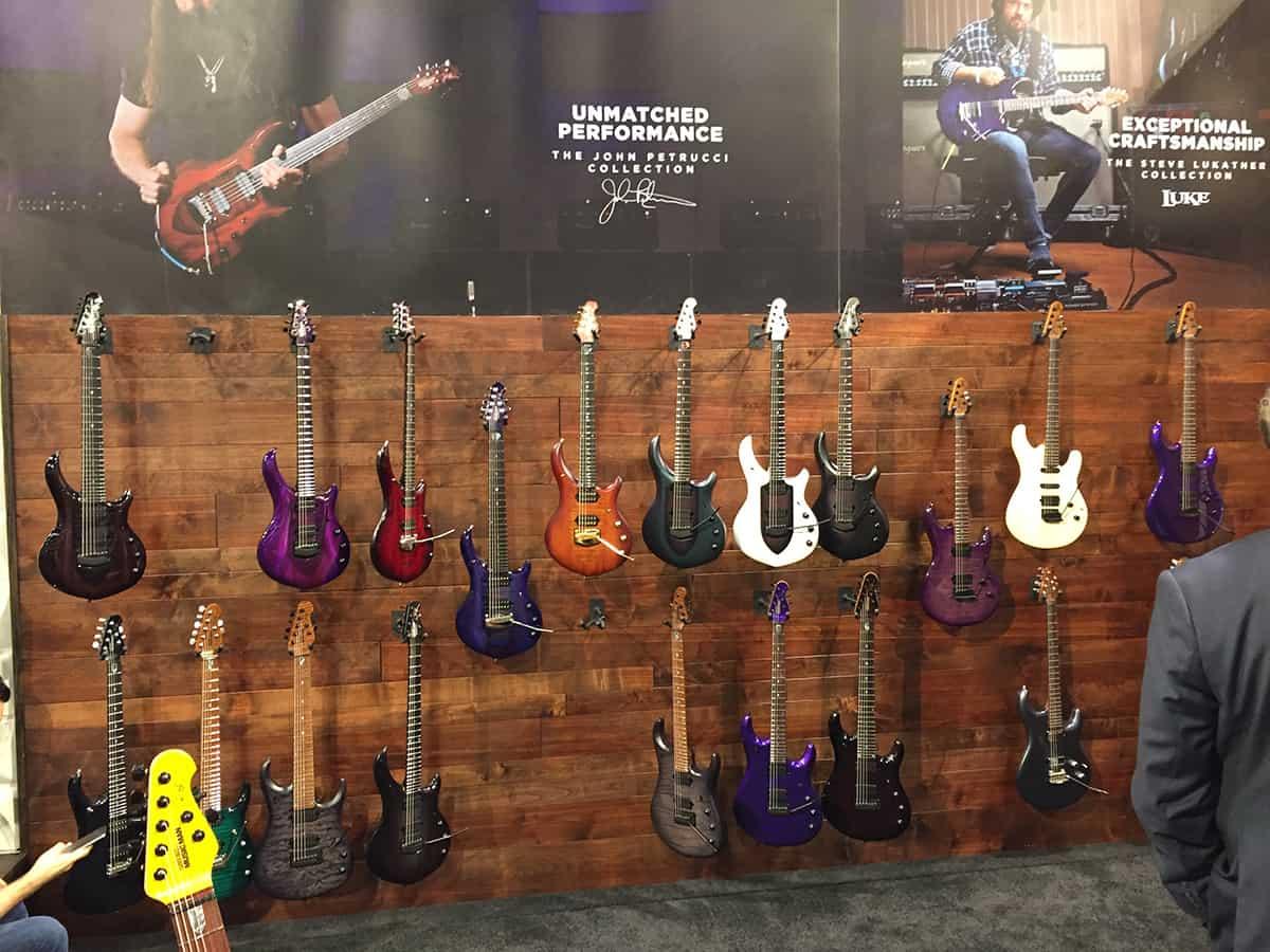 Display wall of Ernie Ball / Music Man Guitars at NAMM 2018
