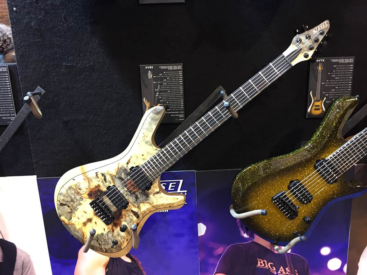 One of many highly figured, exotic wood Kiesel Guitars at NAMM 2018