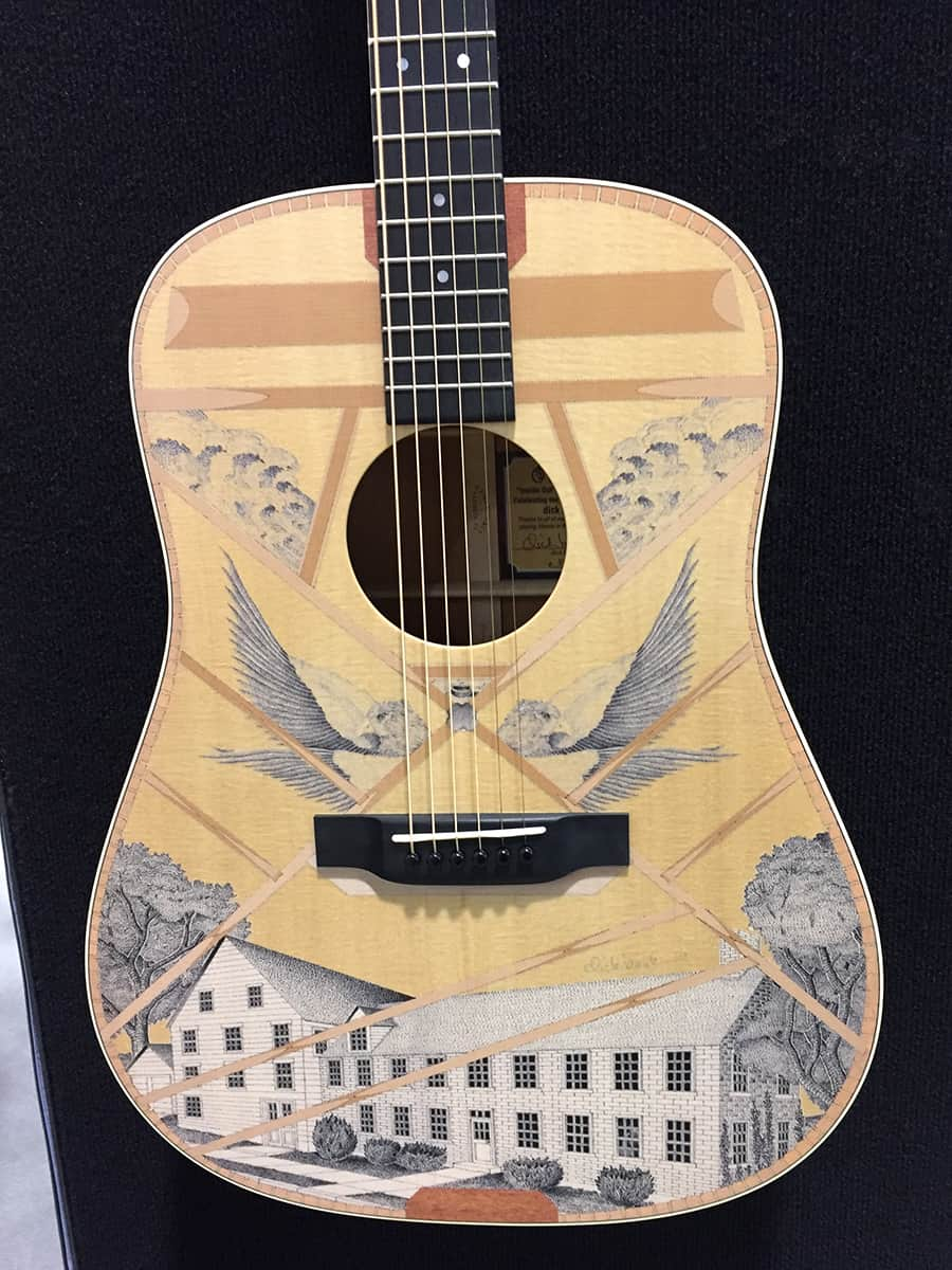 A very ornately inlaid Martin acoustic guitar at NAMM 2018