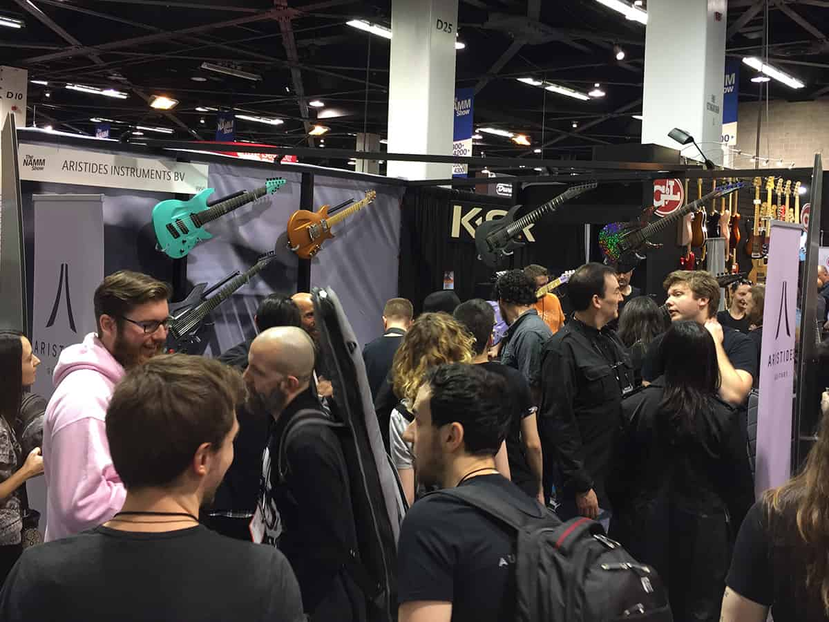 The very crowded Aristides guitars booth at NAMM 2018