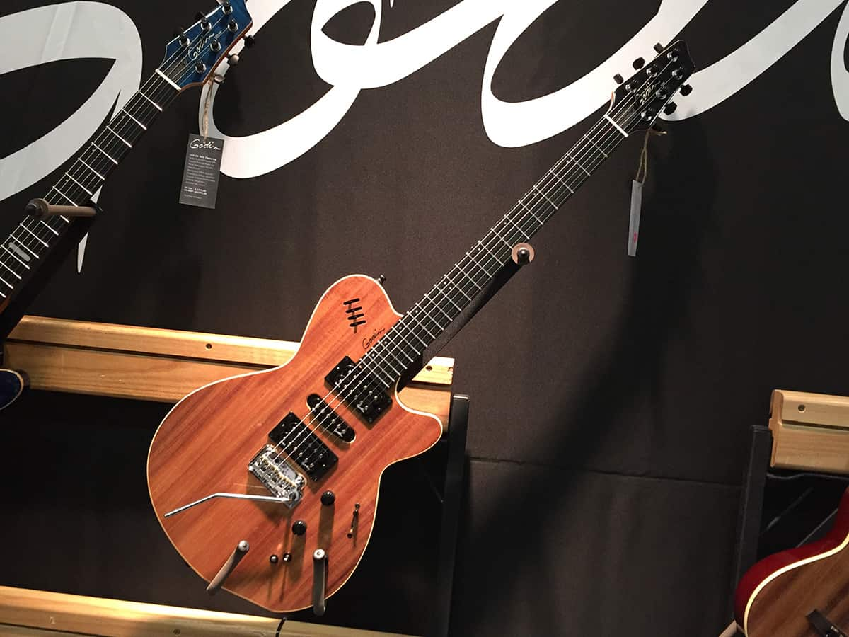 A Godin guitar on the wall at NAMM 2018