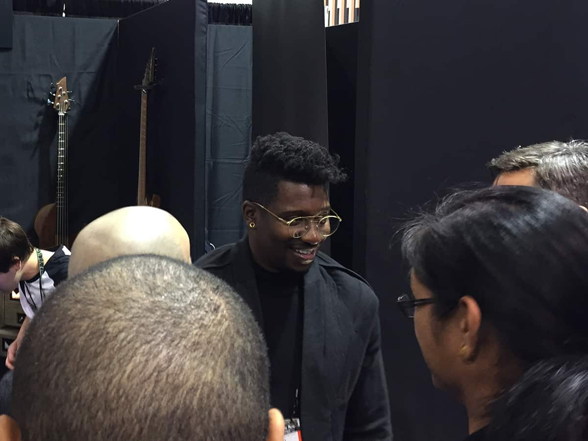 Tosin Abasi answering questions at the Abasi Guitars Booth at NAMM 2018