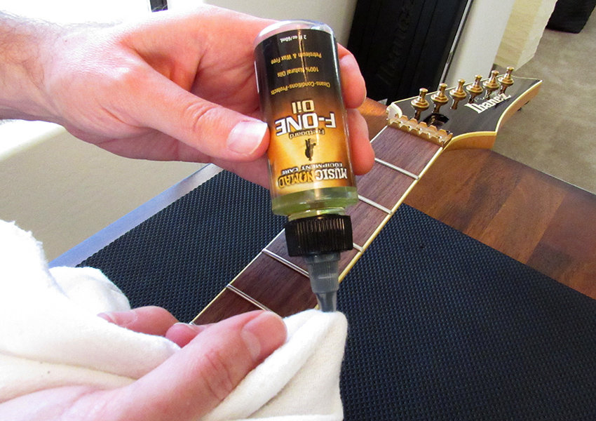 Apply 1-2 drops of fretboard oil per fret
