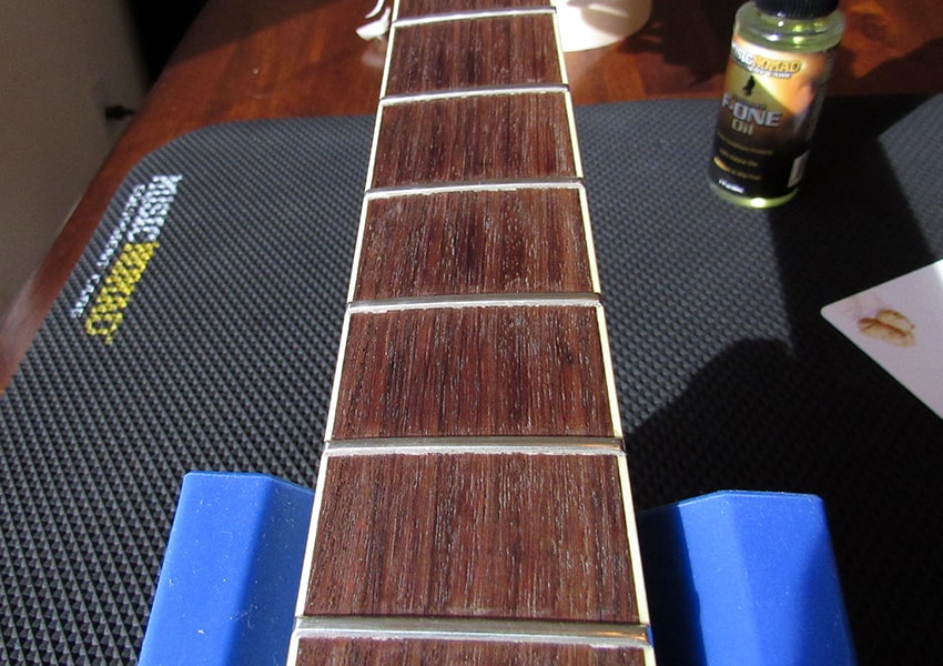 After we're done scraping, the fretboard's already looking pretty good
