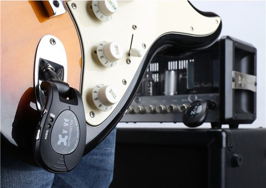 The Xvive transmitter plugged into a Stratocaster jack