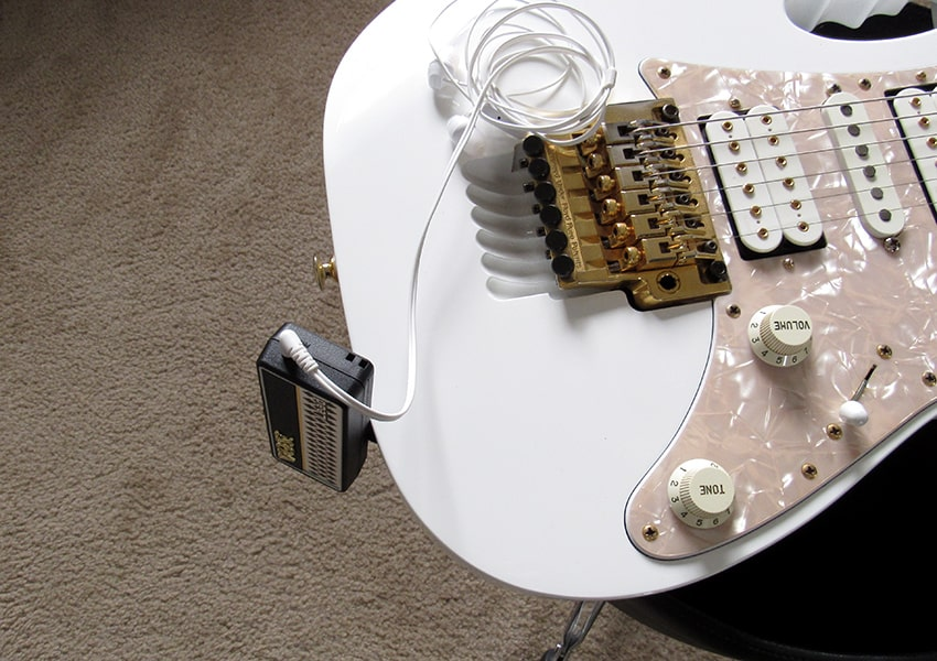 The amPlug plugged into an Ibanez Jem