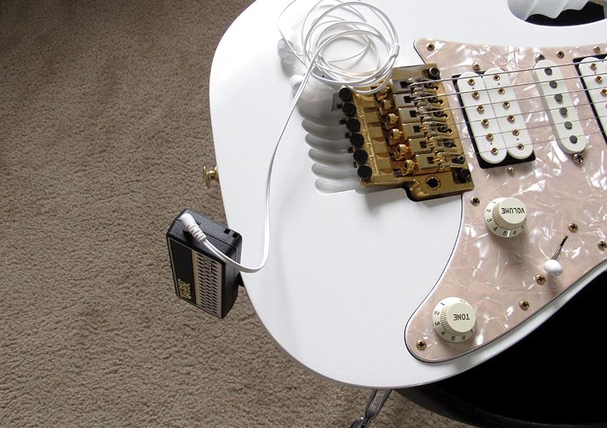 The amPlug plugged into an Ibanez Jem