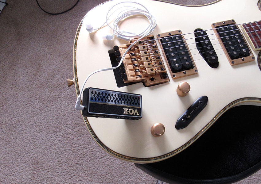 The amPlug plugged into an Ibanez S guitar