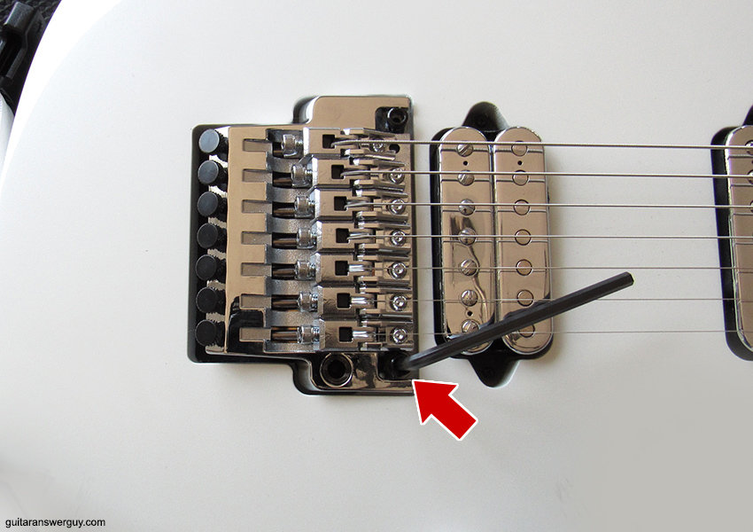 Insert your tremolo's bridge-height hex wrench into one of your bridge studs and note it's position