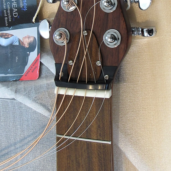String retainer keeps strings in the tuners when the neck is removed