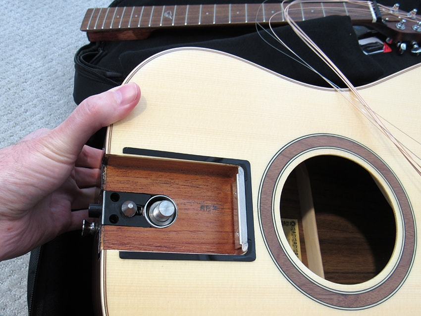 The neck attachment mechanism of the Journey OF420 acoustic travel guitar