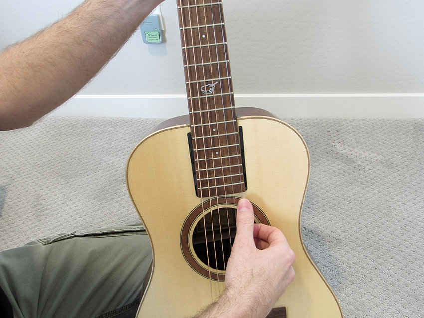 Before tuning, give all the strings a gentle tug to ensure they're fully seated on the string posts and at the nut