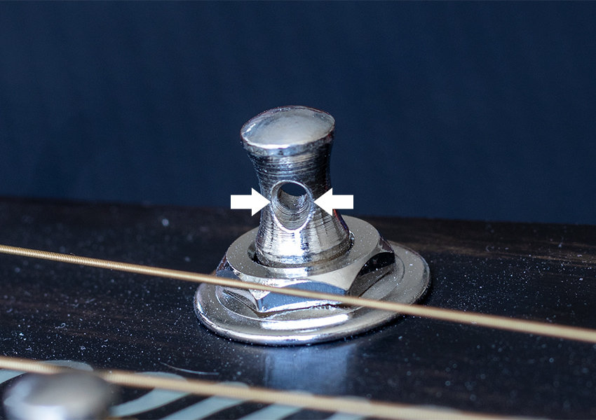 Sharp edges on a guitar's tuning posts can actually cut guitar strings
