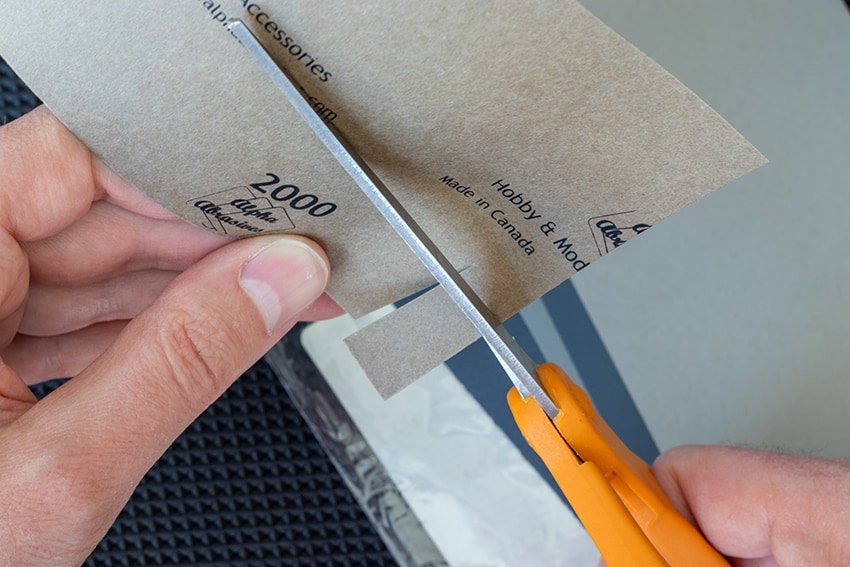Cutting a small, rectangular piece of 2000 grit sandpaper