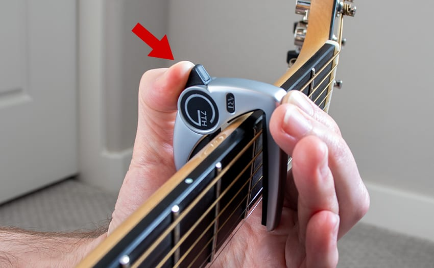 Releasing the capo using an underhanded grip