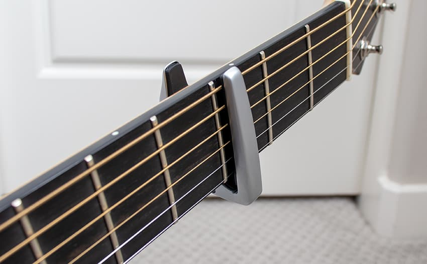 The Performance 3 capo in place from underneath