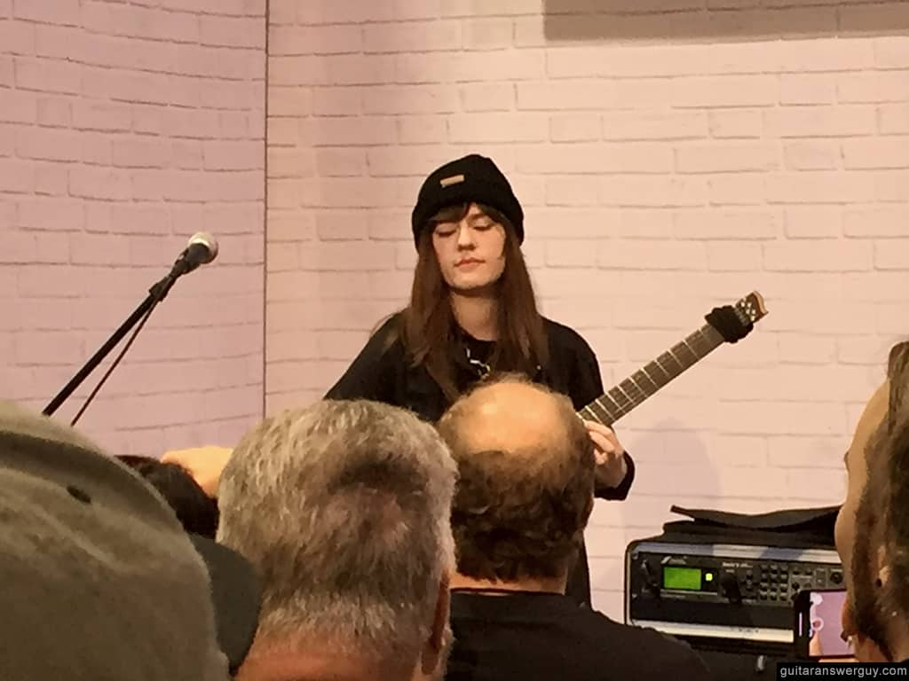 Sarah Longfield performing at the Fishman booth at NAMM 2020